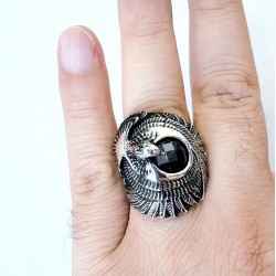 Men's silver eagle ring highlights the sun